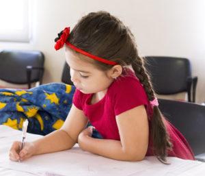 Child writing during tutoring